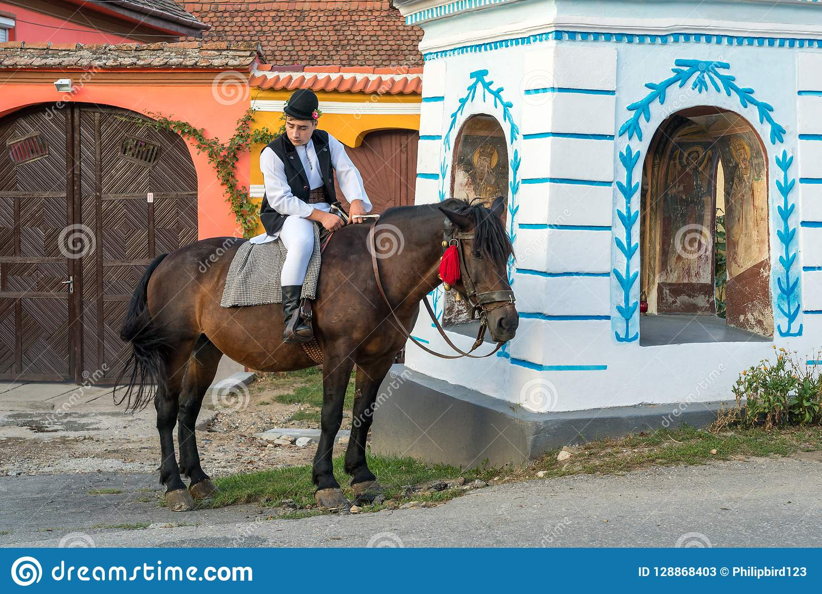 SIBIEL, TRANSYLVANIA/ROMANIA - SEPTEMBER 16 : Young man in traditional dress on a horse in Sibiel Transylvania Romania on