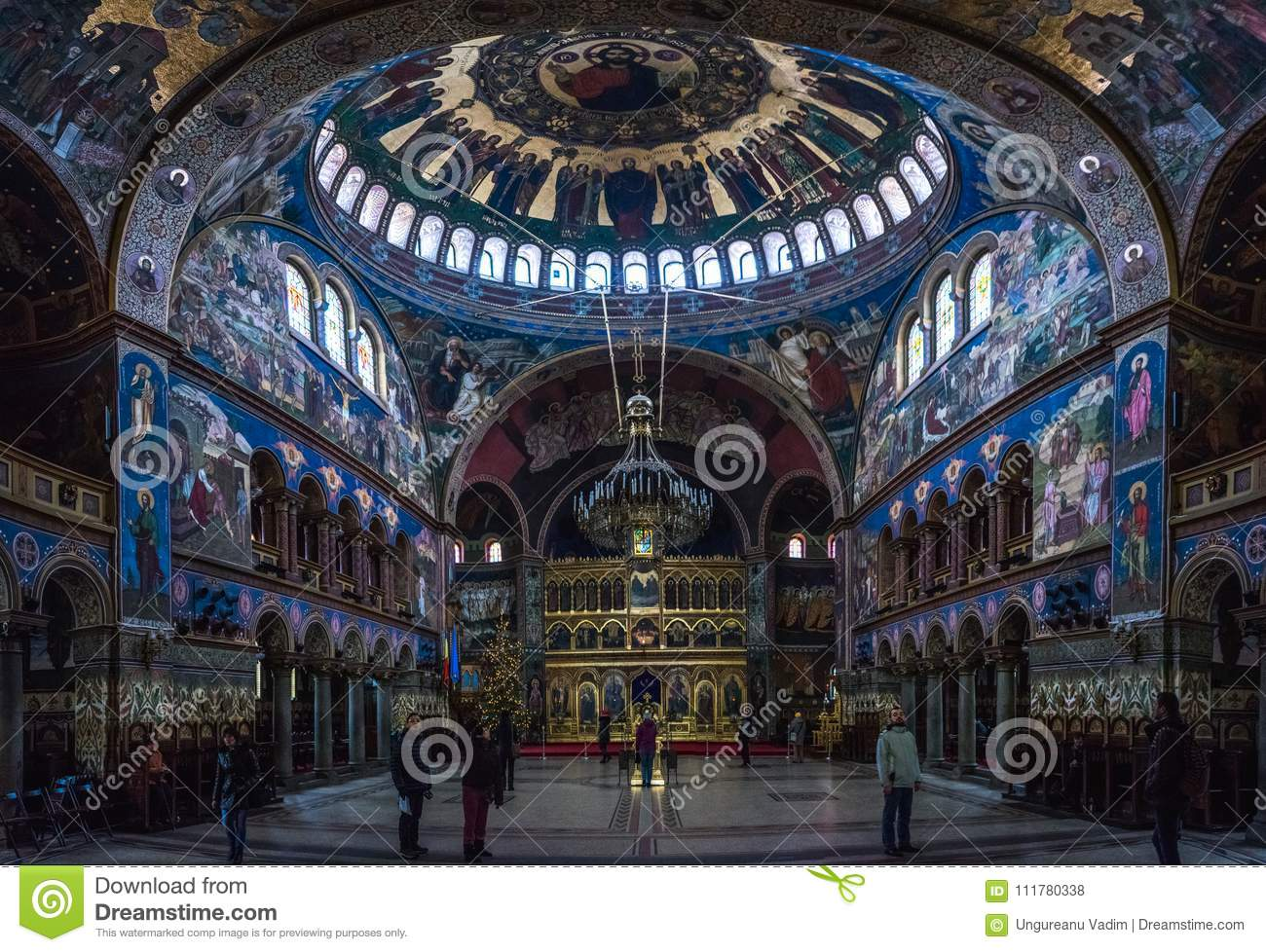 SIBIU, ROMANIA - 7 JANUARY 2016: People admiring the interior of the Holy Trinity Cathedral in Sibiu, Romania.