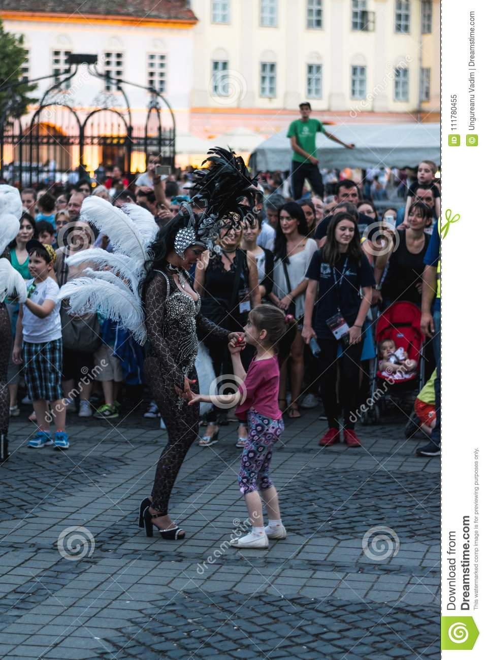 SIBIU, ROMANIA - 17 JUNE 2016: A girl is dancing with a member of Torrevieja Carnival Group dancers, during Sibiu International Th