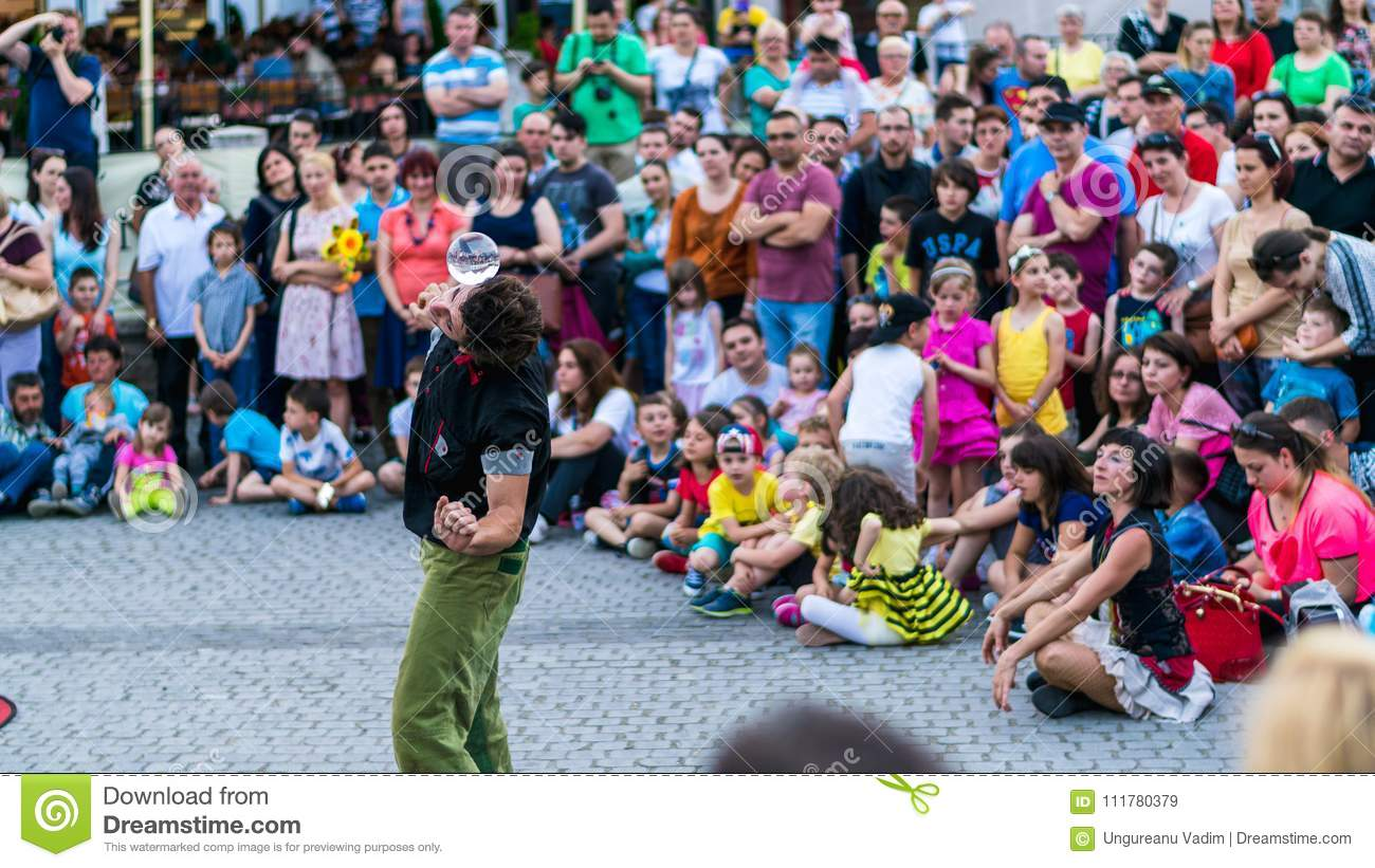 SIBIU, ROMANIA - 17 JUNE 2016: A member of Kinemtatos, Manoamano Circo, Argentina performing a trick in the Little Square during S