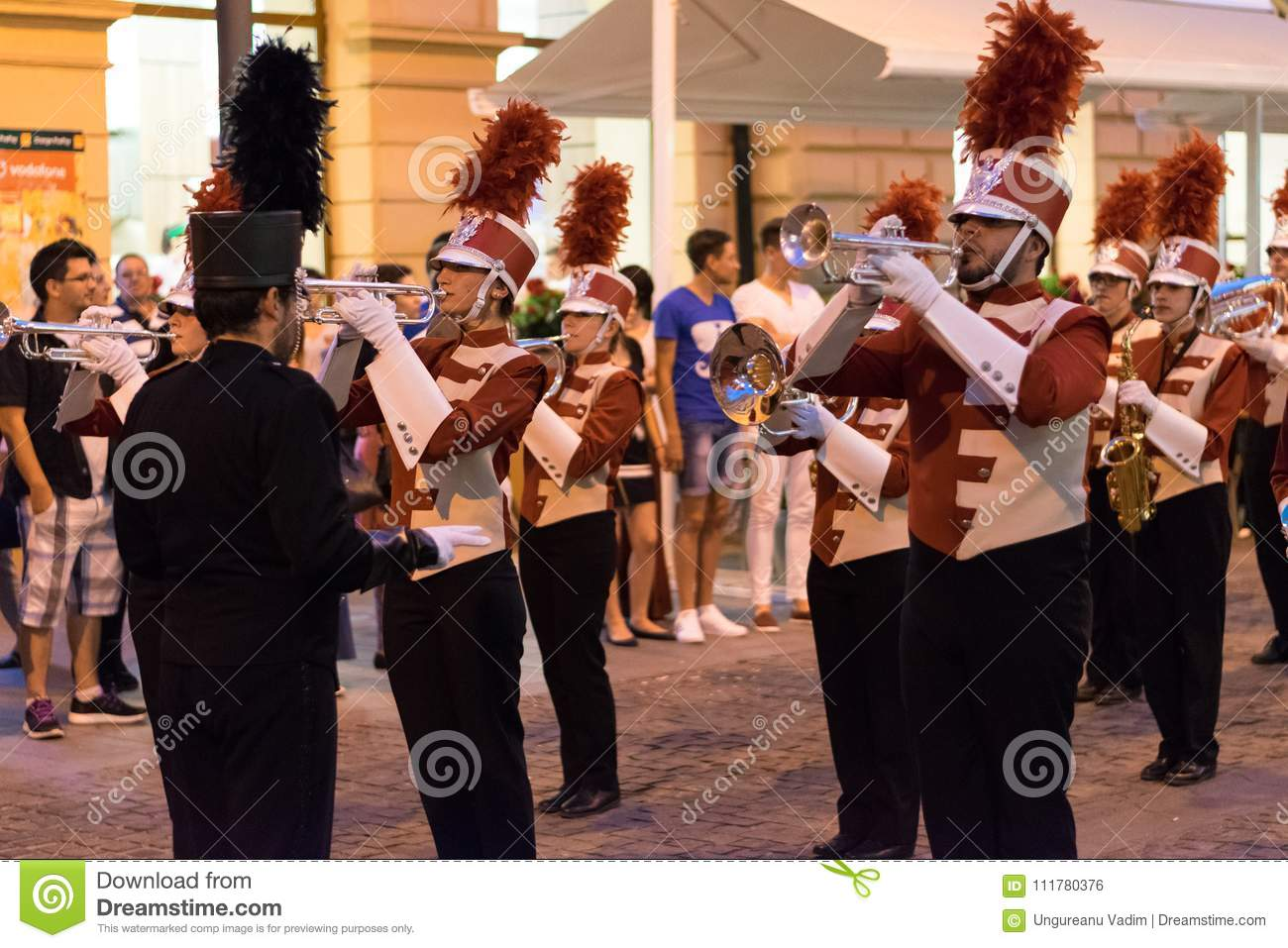 SIBIU, ROMANIA - 17 JUNE 2016: Members of Triuggio Marching Band performing at the Sibiu International Theatre Festival, on Balces