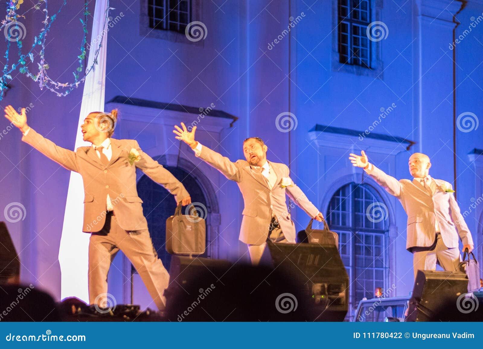 SIBIU, ROMANIA - 17 JUNE 2016: Members of the VOALA Station performing in the Big Square, during Sibiu International Theatre Festi