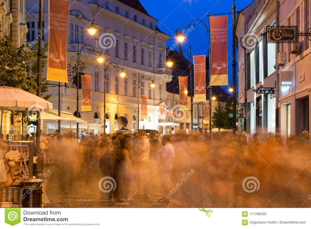 SIBIU, ROMANIA - 17 JUNE 2016: People passing by on a pedestrian walkway during Sibiu International Theatre Festival, Sibiu, Roman