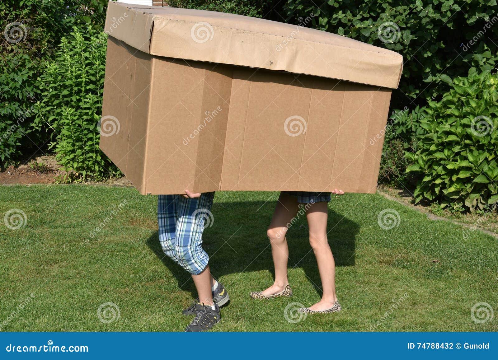 Siblings with cardboard box