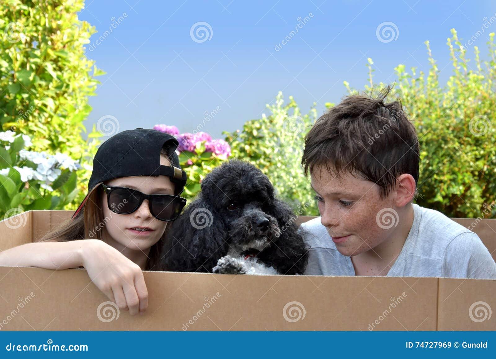 Siblings and dog