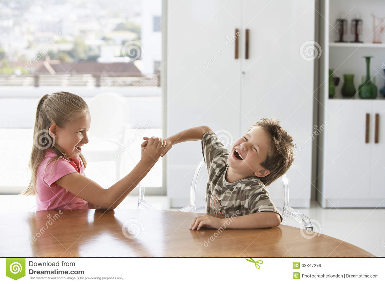 Siblings Fighting At Dining Table Stock Photo Image Of Lifestyle