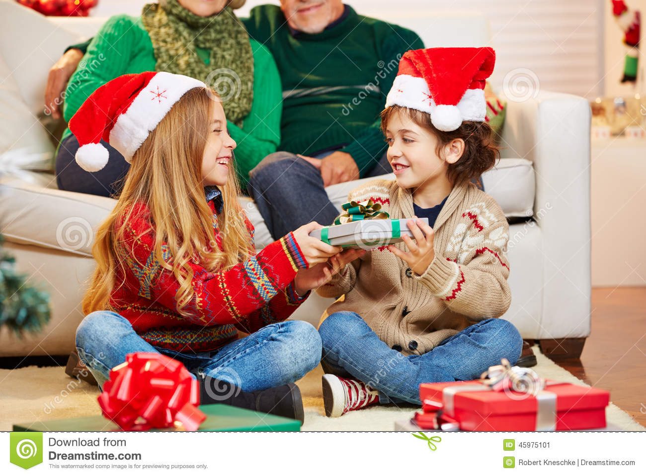 Siblings Giving Gifts To Each Other At Christmas Stock ...