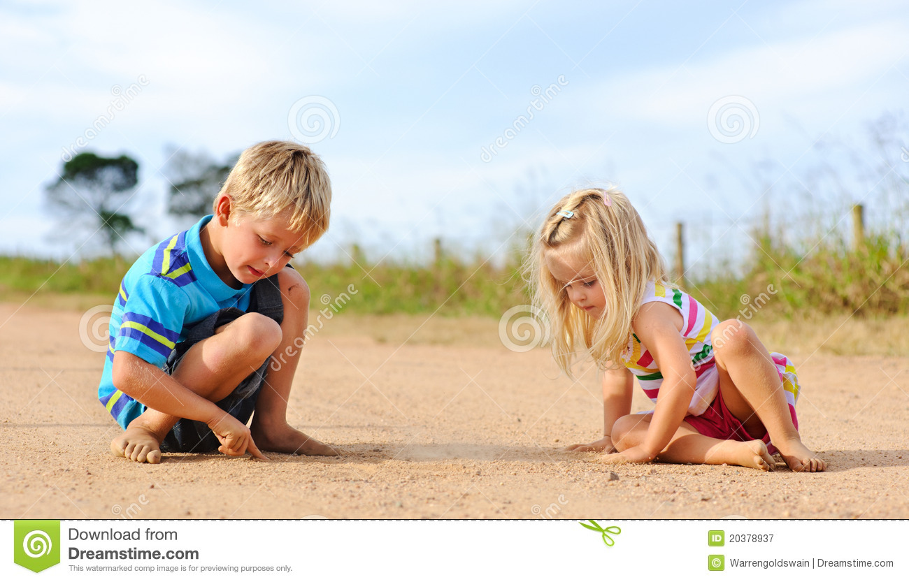 Siblings playing outdoors
