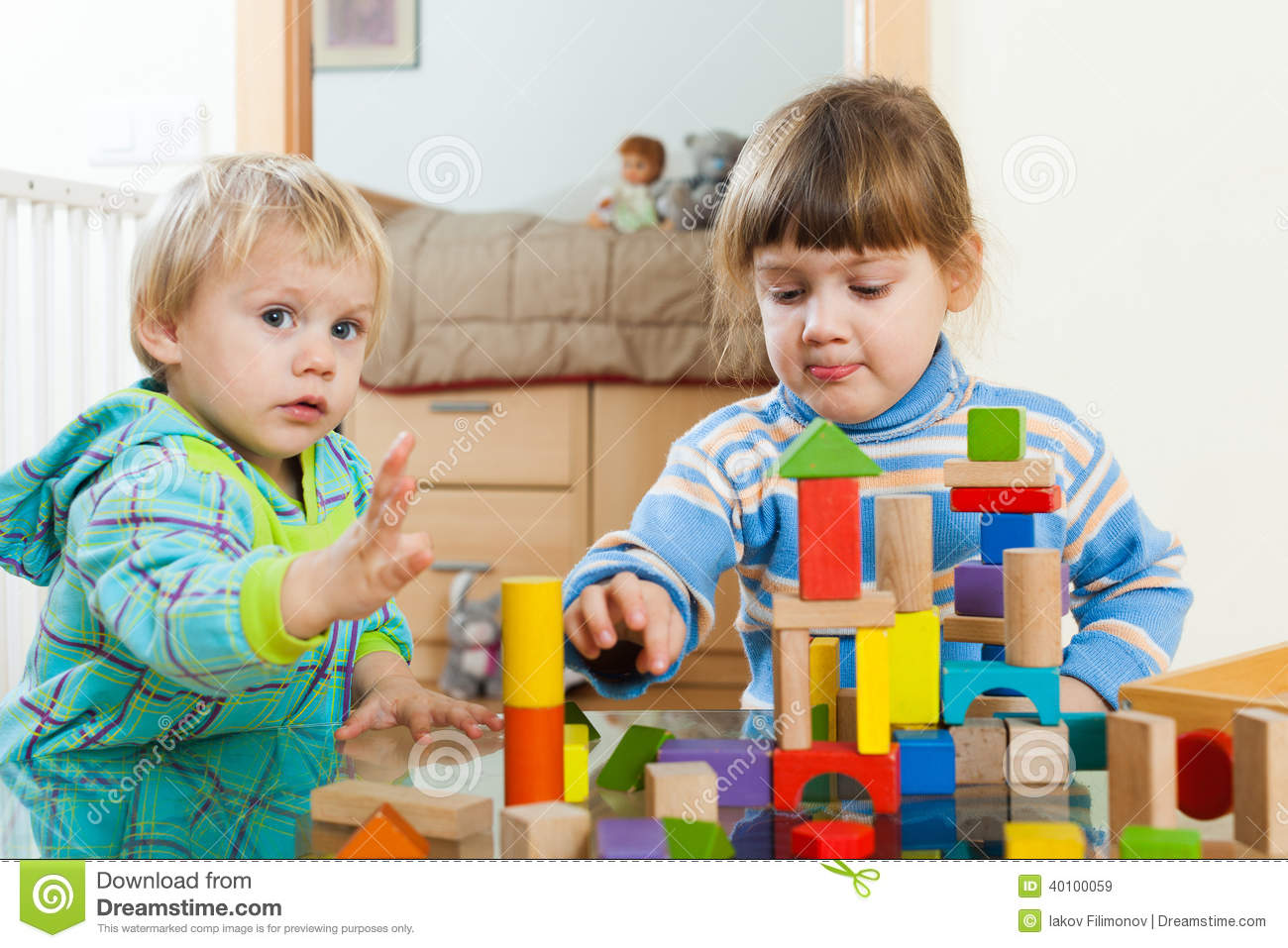 Toys For Siblings : Siblings playing with wooden toys stock photo image
