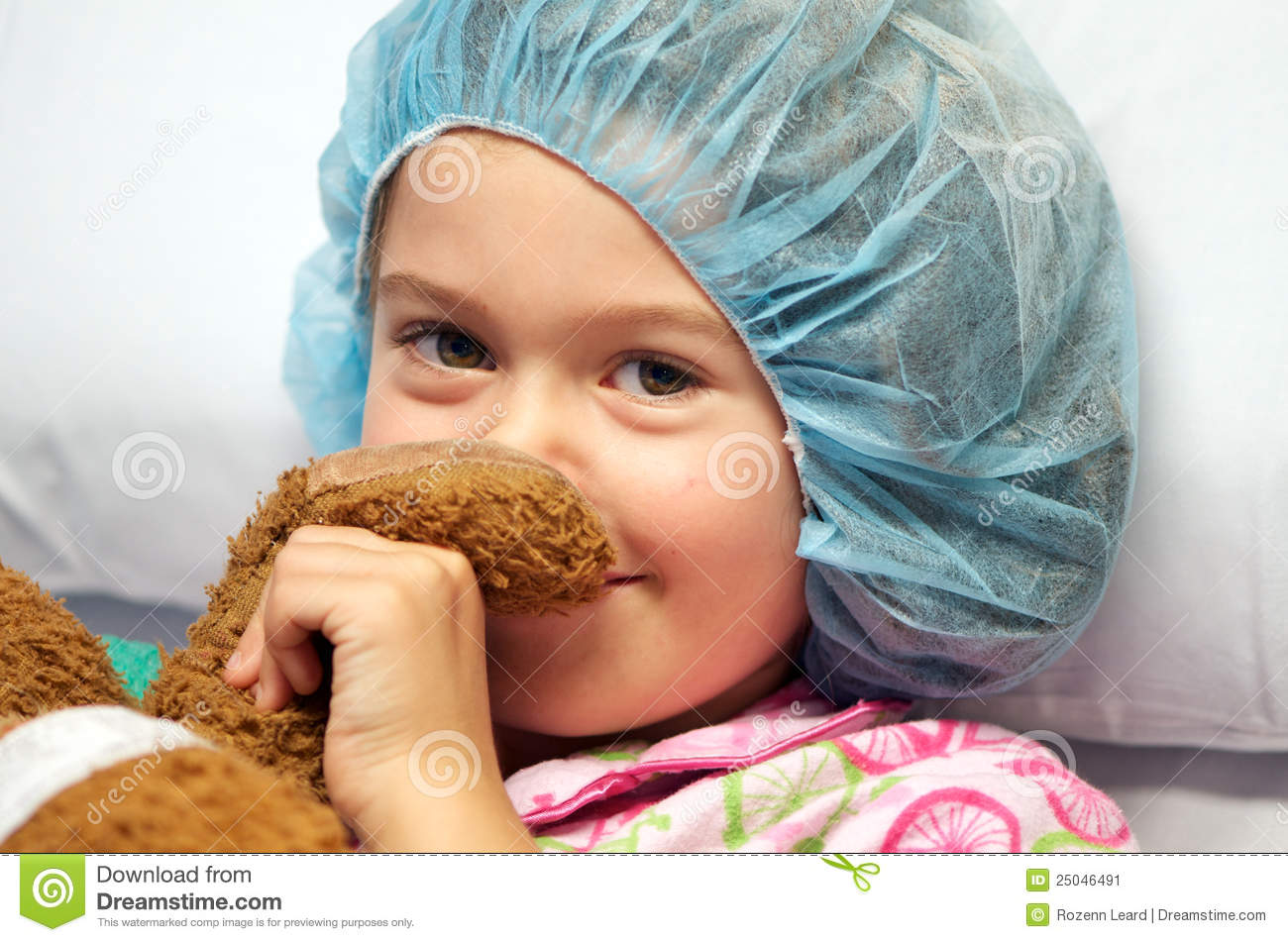Sick child wearing surgical cap