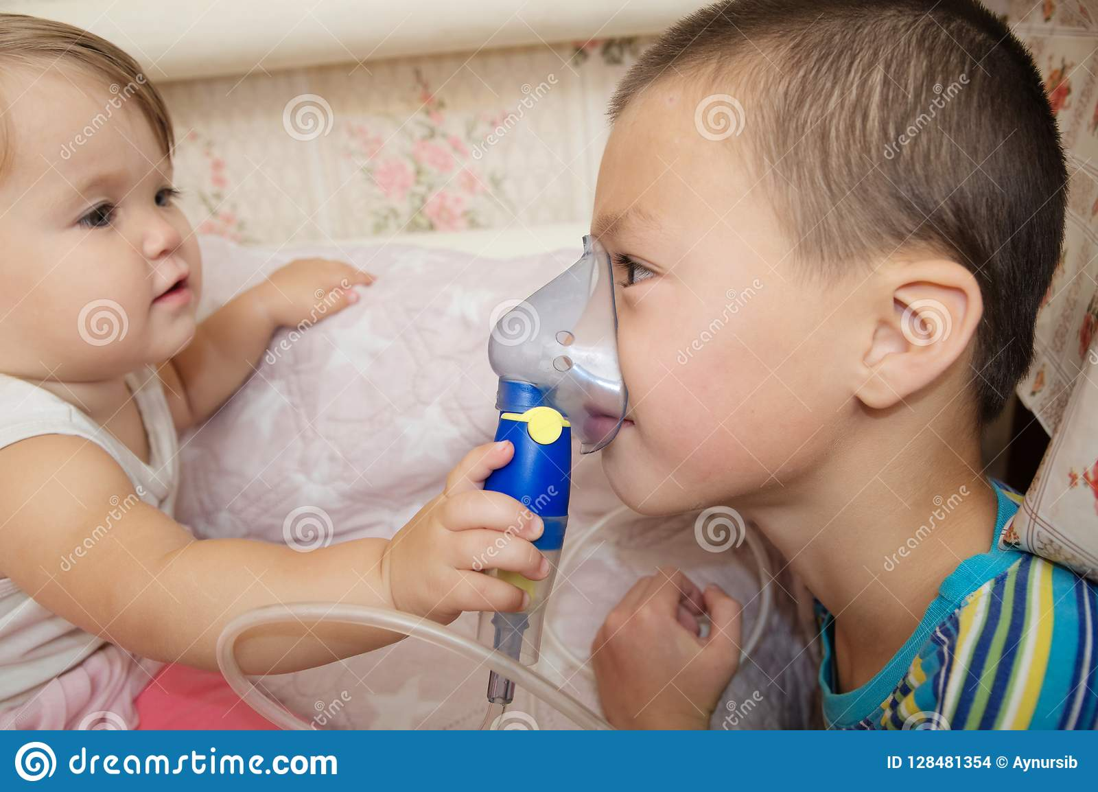 Sick Children - Baby Girl And Boy Use Nebulizer Mask For