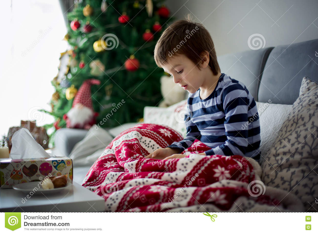 Sick Little Child, Boy, Playing At Home On Christmas On Mobile P ...