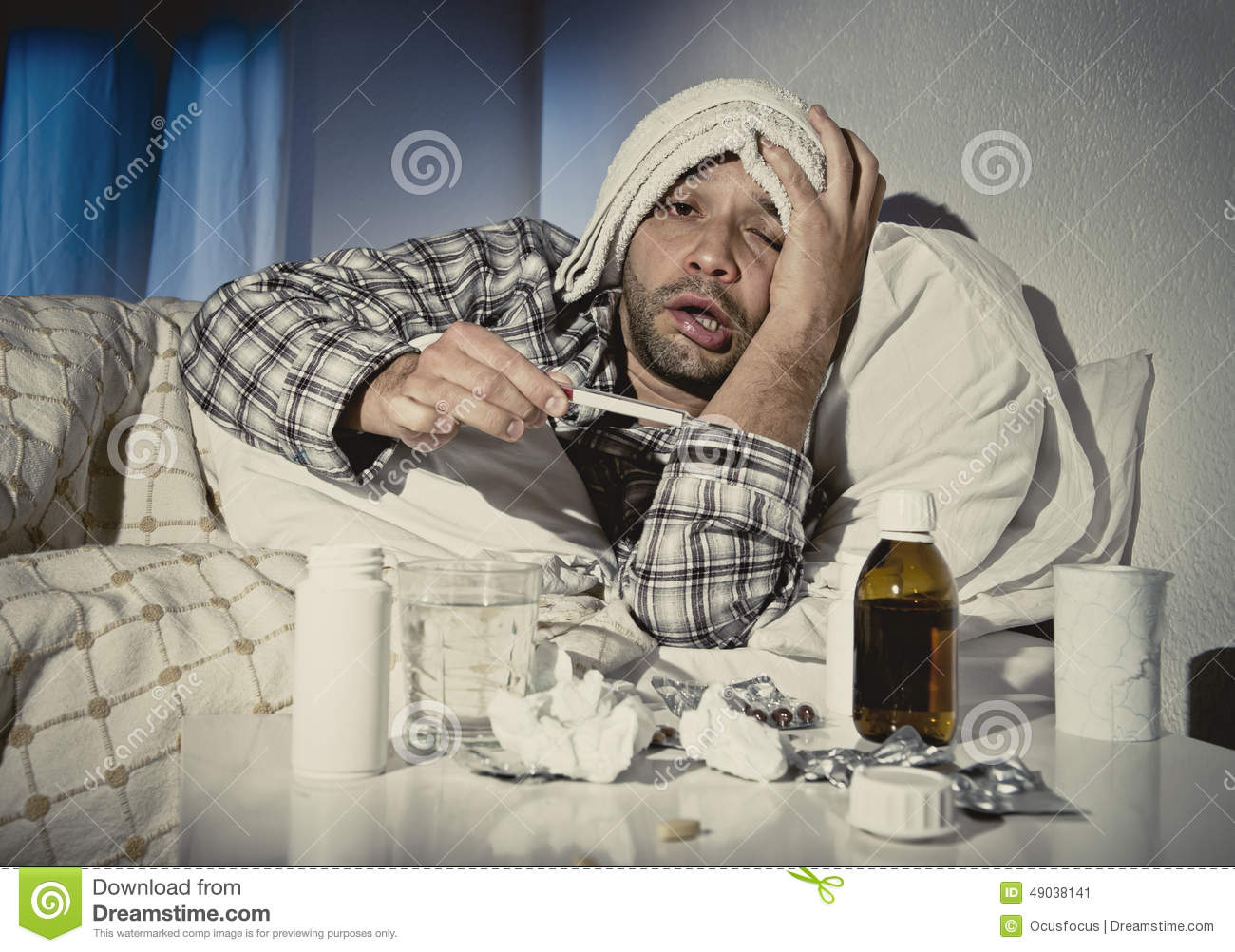 Sick wasted man lying in bed wearing pajama suffering cold and winter ...