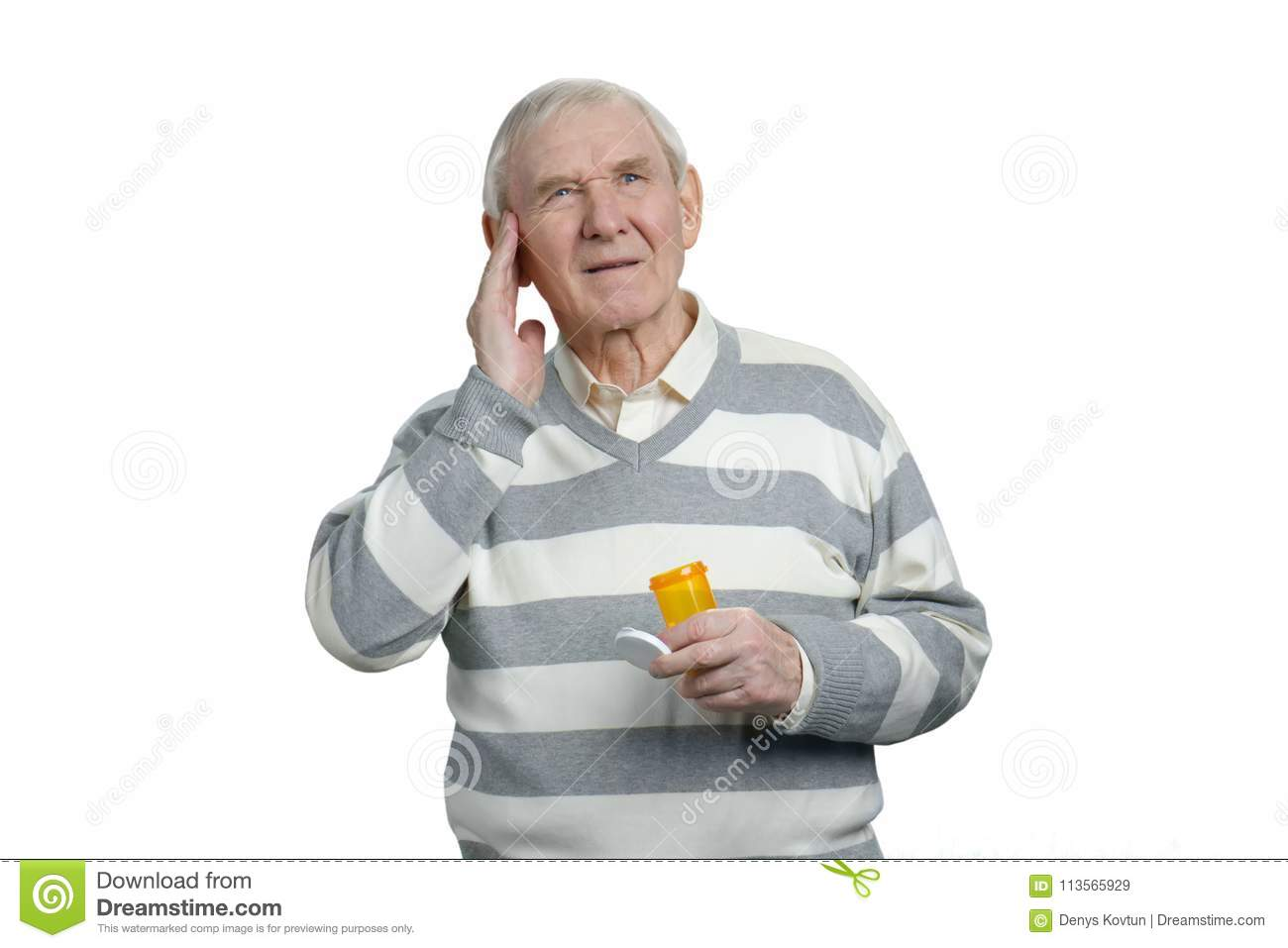 Sick Senior Man With Headache And Bottle Of Pills