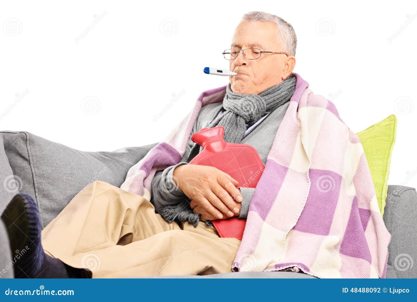 Sick senior measuring his body temperature