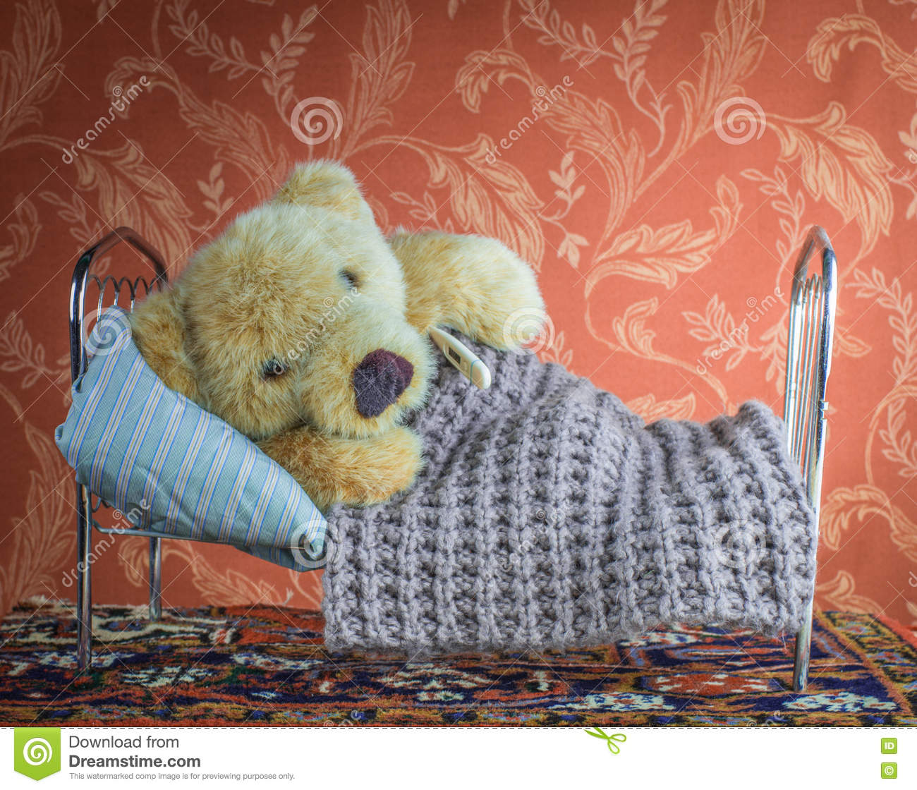 Sick Teddy Bear Lying With Thermometer In Bed Home