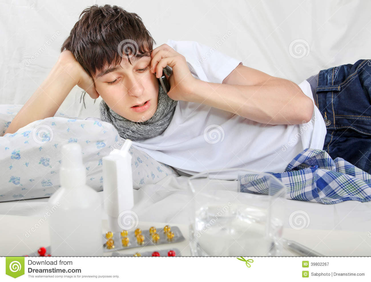 Sick Teenager Calling On Cellphone Stock Photo