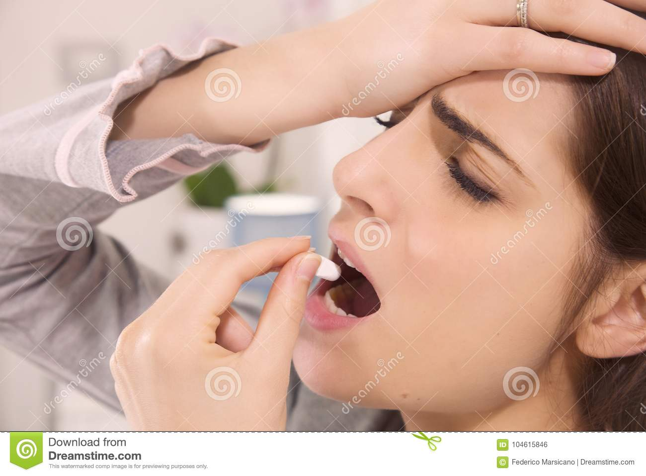 Sick Woman In Bed Taking Pill Medicine Closeup