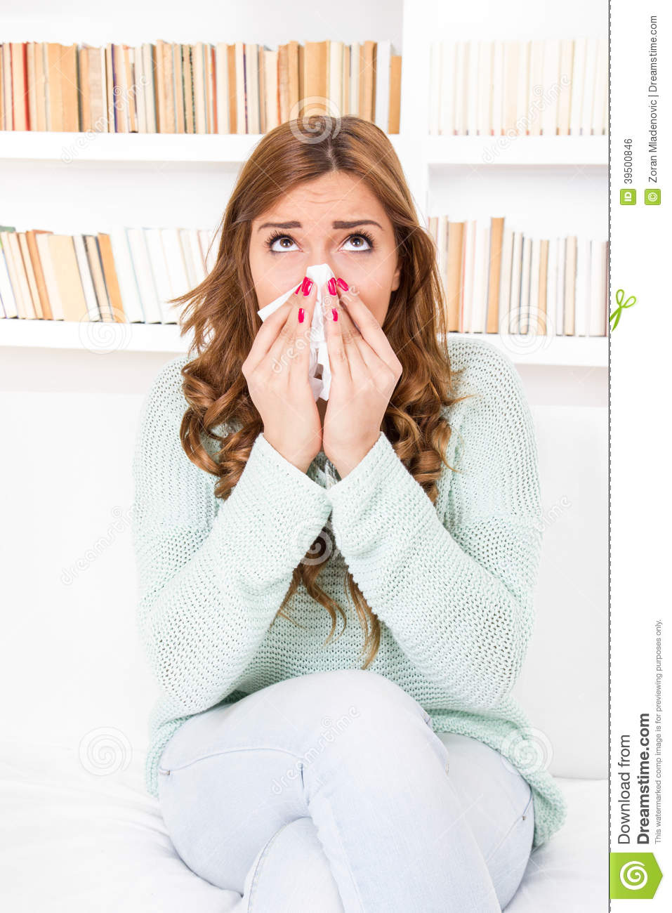 Sick woman caught cold blowing her nose into handkerchief