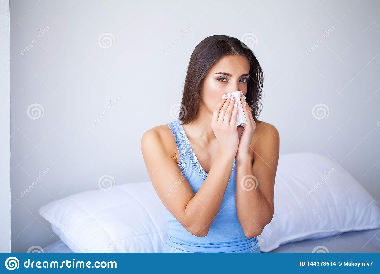 Sick Woman and Flu. Woman Caught Cold. Sneezing into Tissue