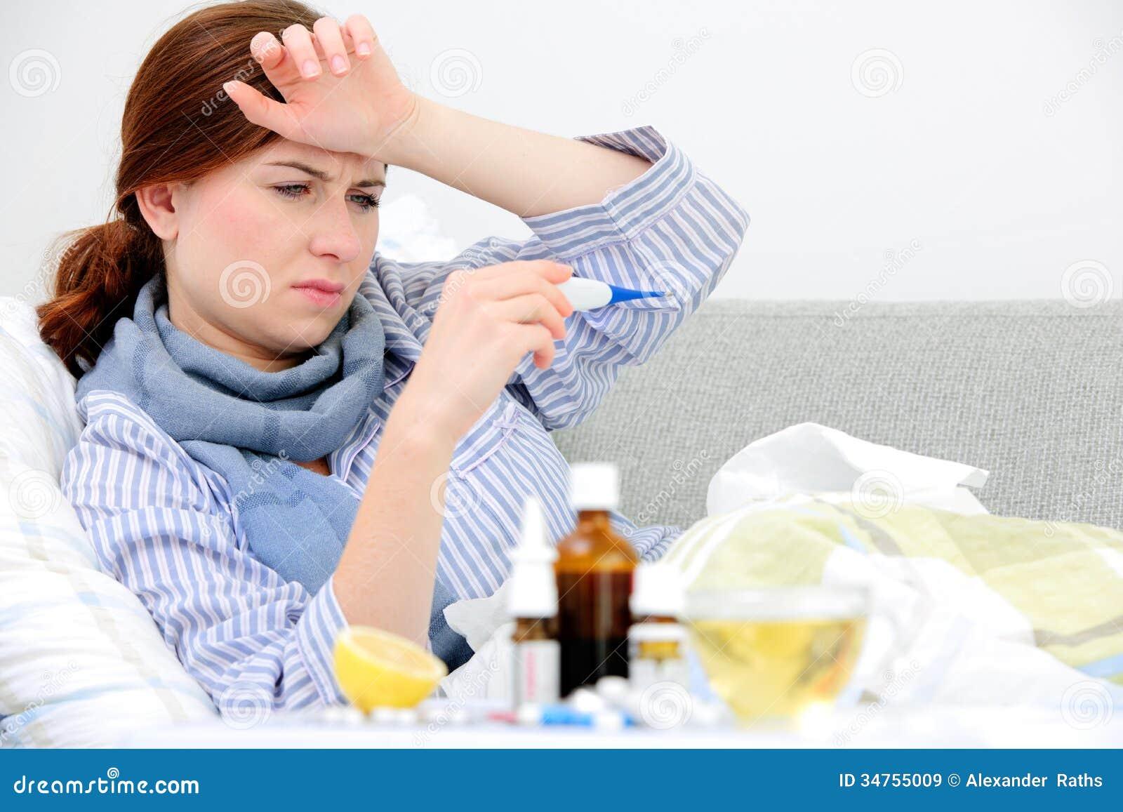 Sick Woman Lying In Be...