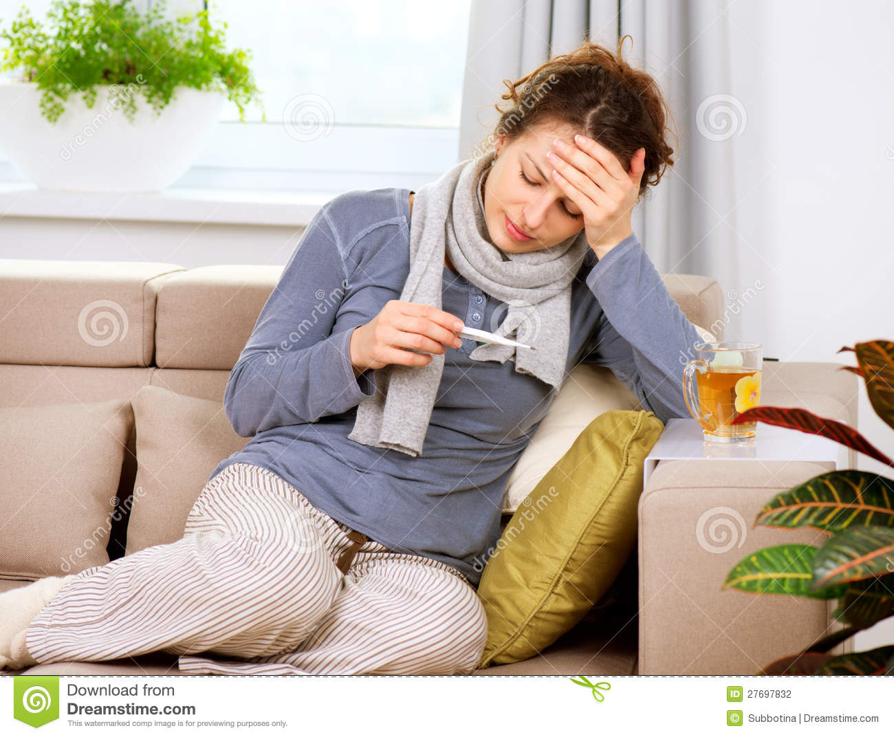 Sick Woman with Thermometer
