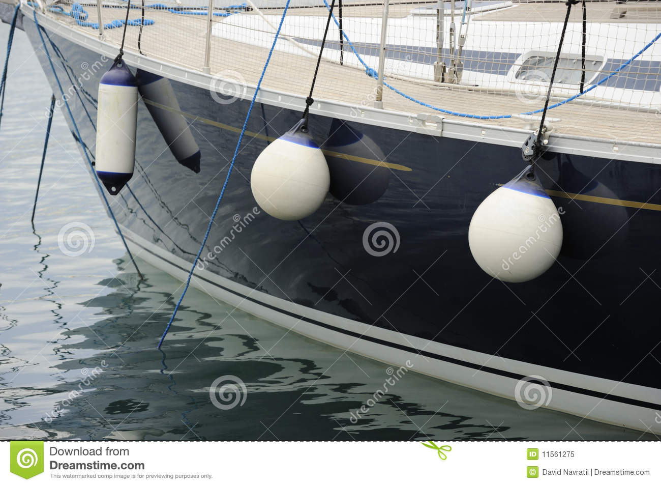 Side of a boat with docking fenders
