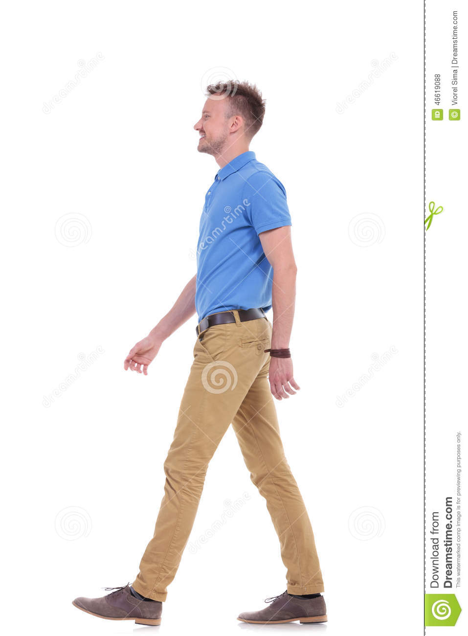 Full length side view picture of a young casual man walking forward ...