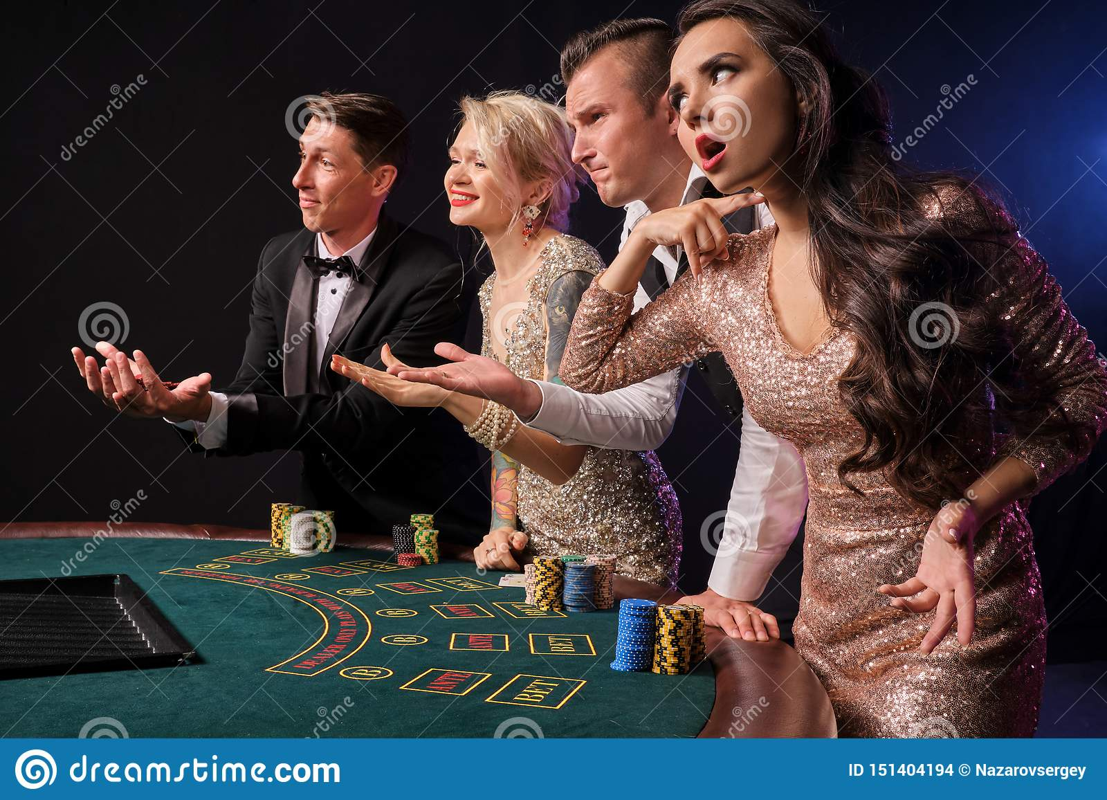 Group Of A Stylish Rich Friends Are Playing Poker At Casino. Stock Photo -  Image of dealer, opportunity: 151404194