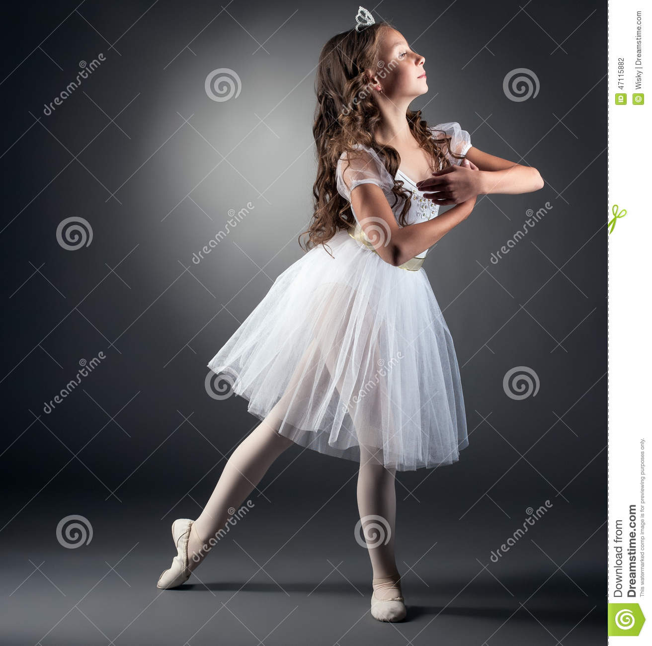 Modern dress clothes for a woman - Side View Of Adorable Little Ballerina Posing Stock Photo Image