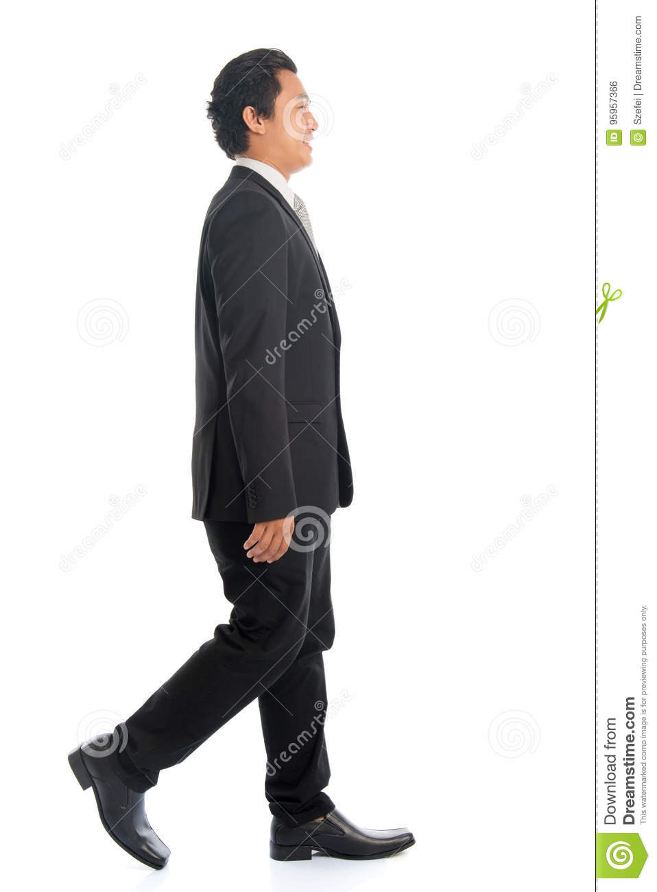 4556e89bc07c Full length side view of attractive young Southeast Asian businessman  walking, isolated on white background.