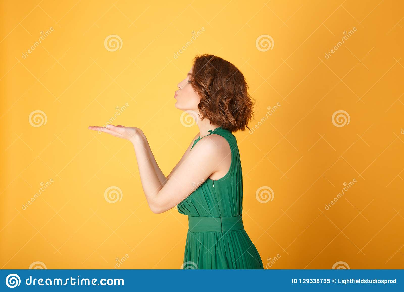 Side View Of Attractive Woman Blowing Kisses Stock Image