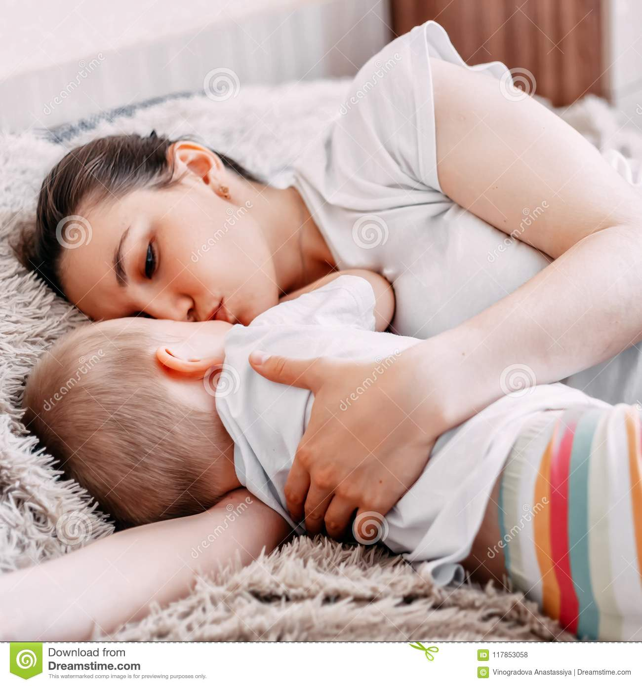 Mother And Baby Boy Sleeping Together On Bed Stock Photo Image