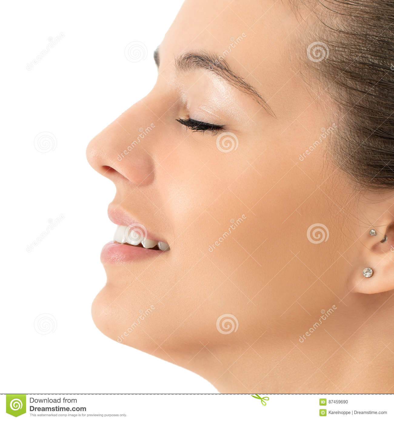 Side View Beauty Portrait Of Young Woman Smiling. Stock