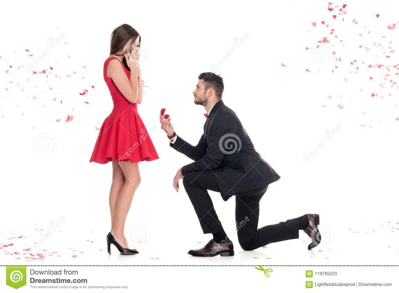 side view of boyfriend proposing girlfriend and standing on knee