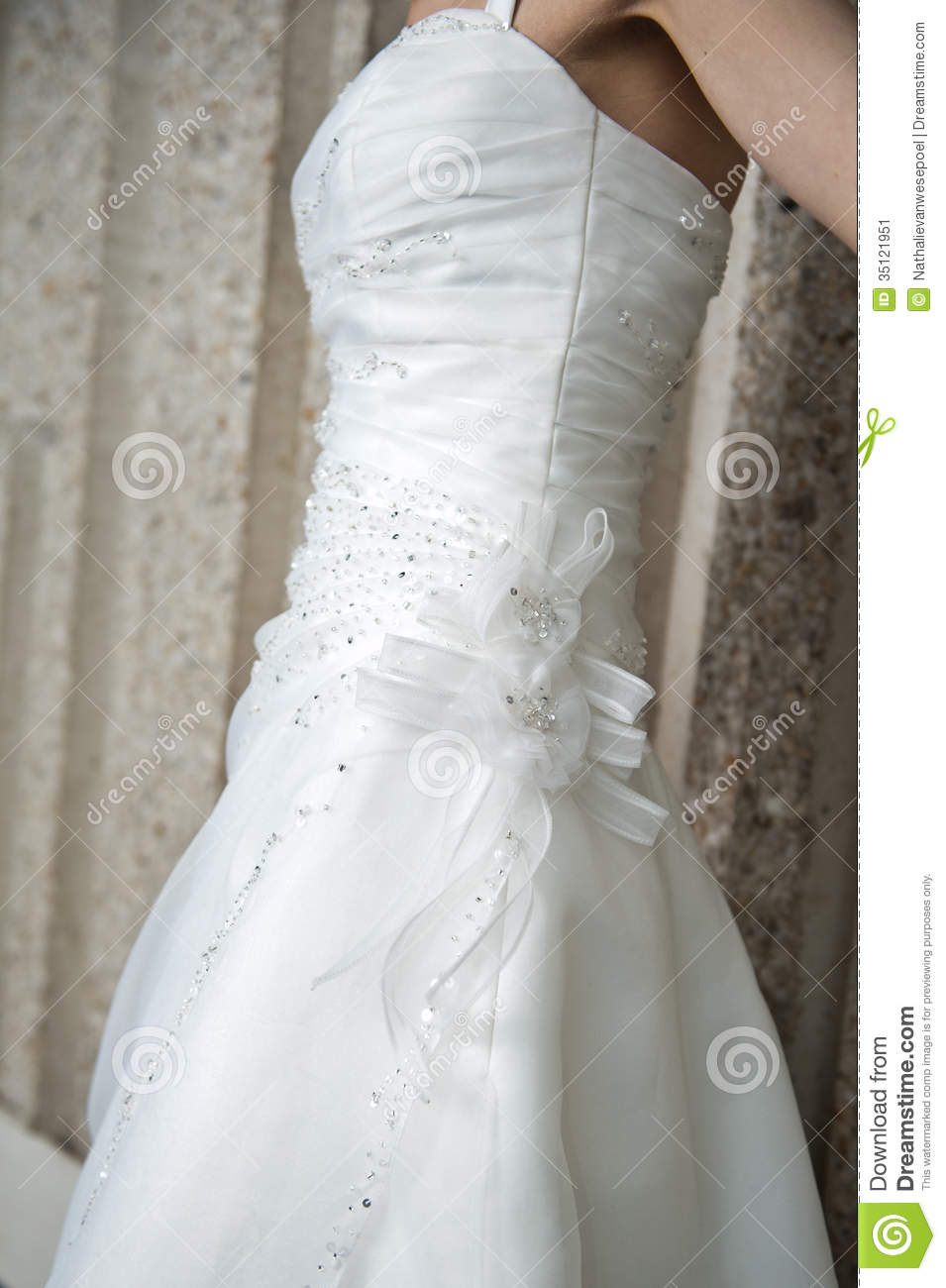 side view of a bride in a wedding dress stock image