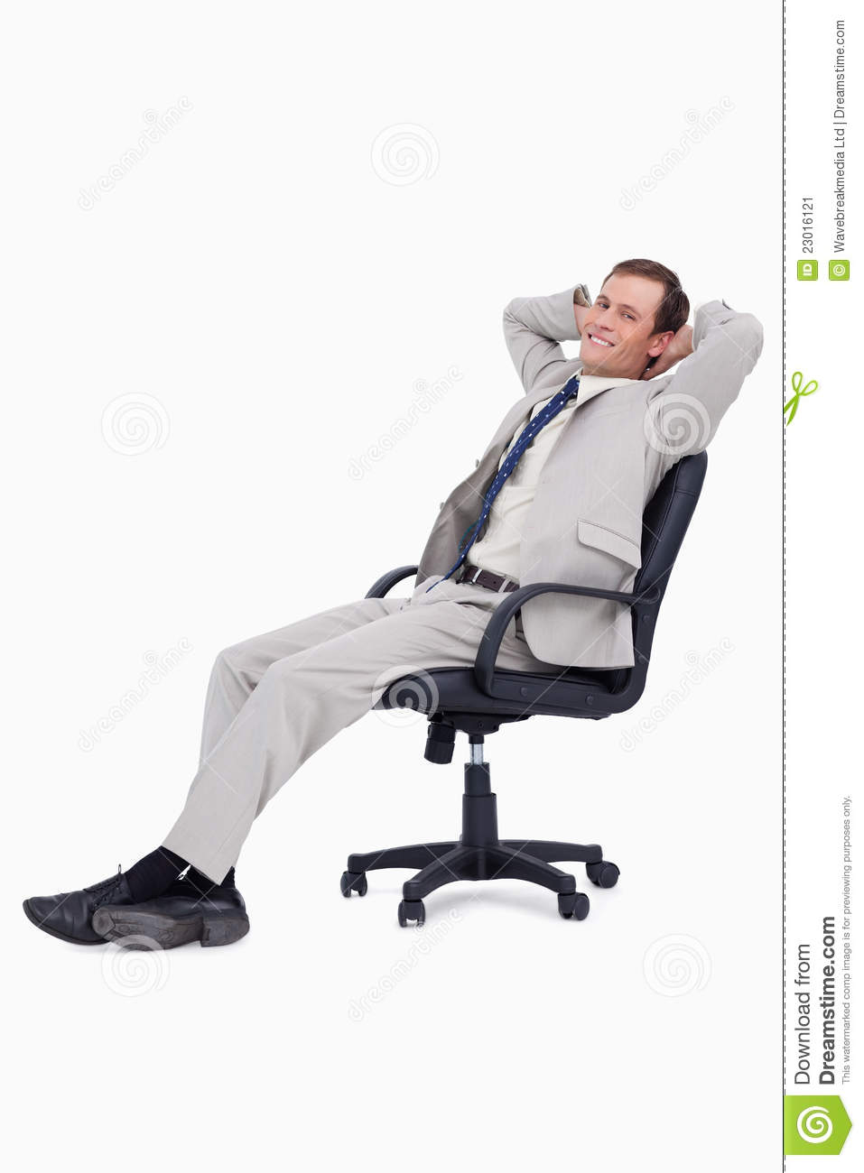 Side View Of Businessman Leaning Back In His Chair Stock