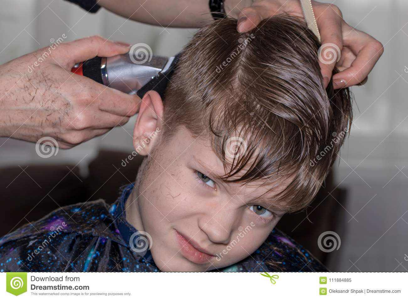 Side View Of Cute Little Boy Getting Haircut By Hairdresser At T