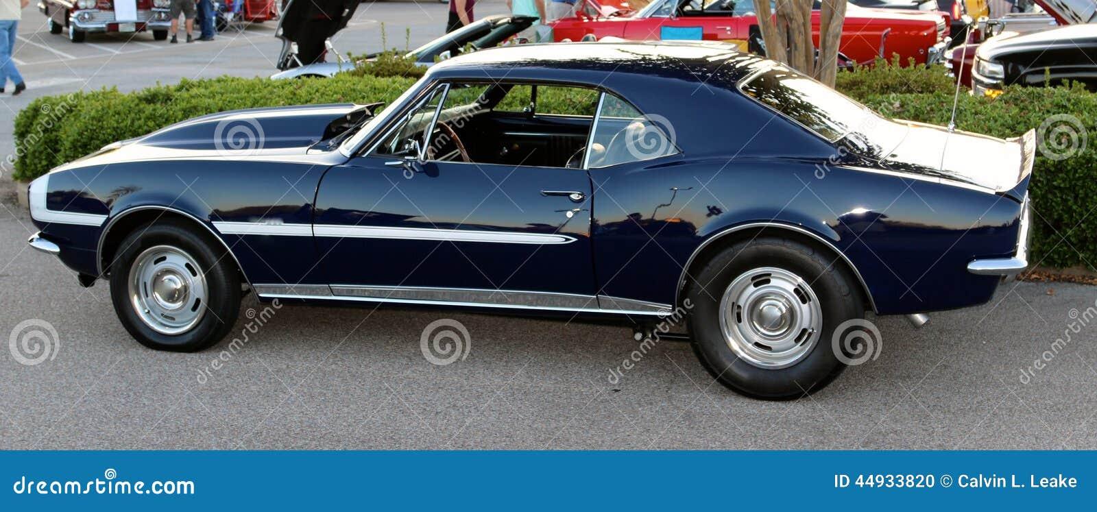 Side view of dark blue antique Chevy Camaro