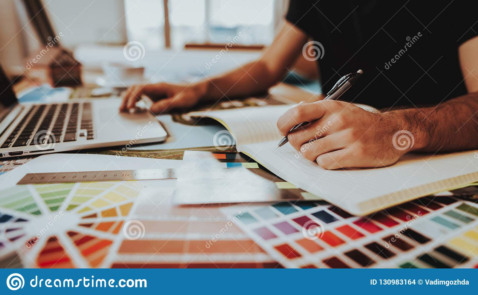 Side View of Graphic Designer Working on Project