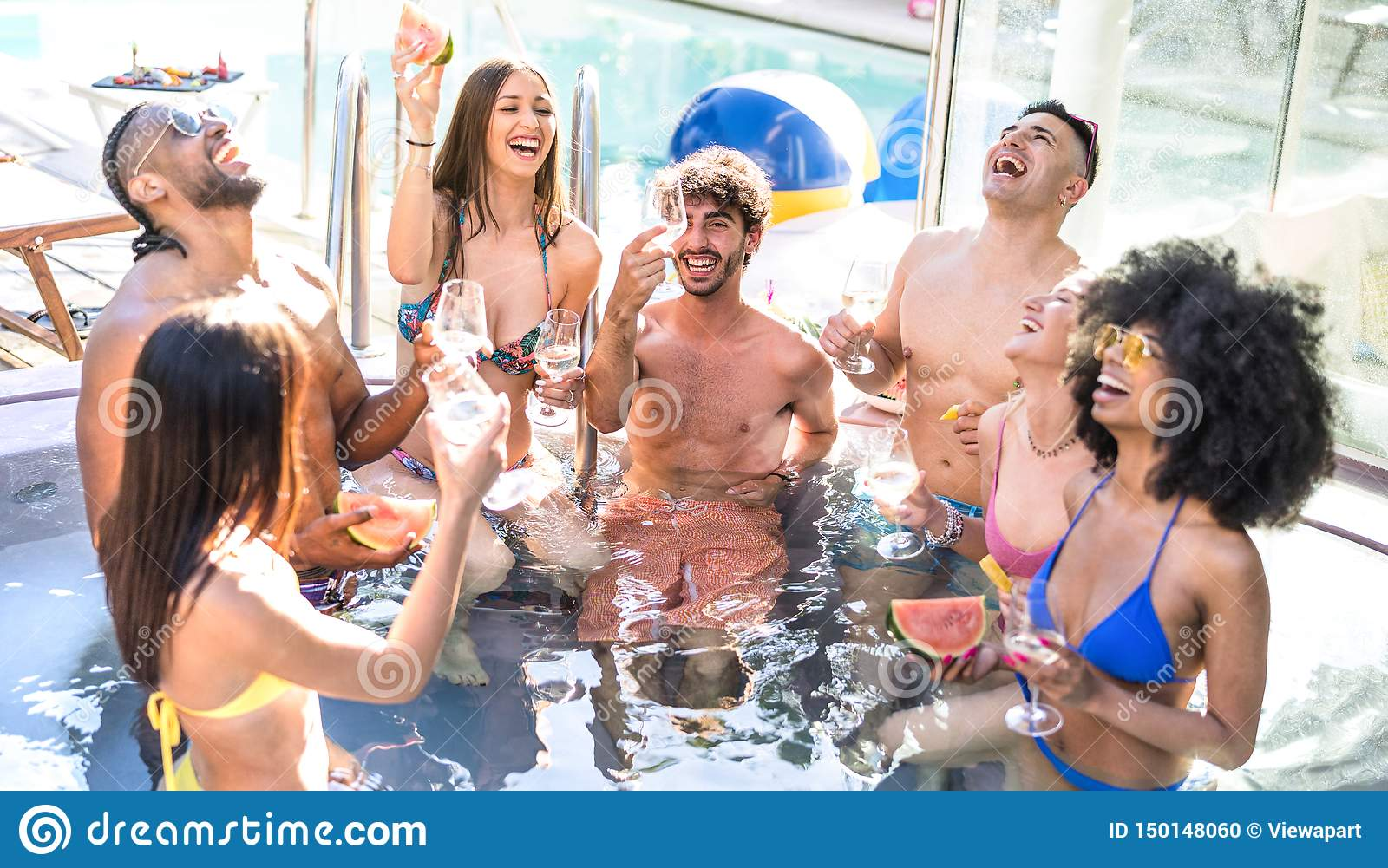 Side view of happy friends group drinking white wine champagne at swimming pool party - Luxury vacation concept