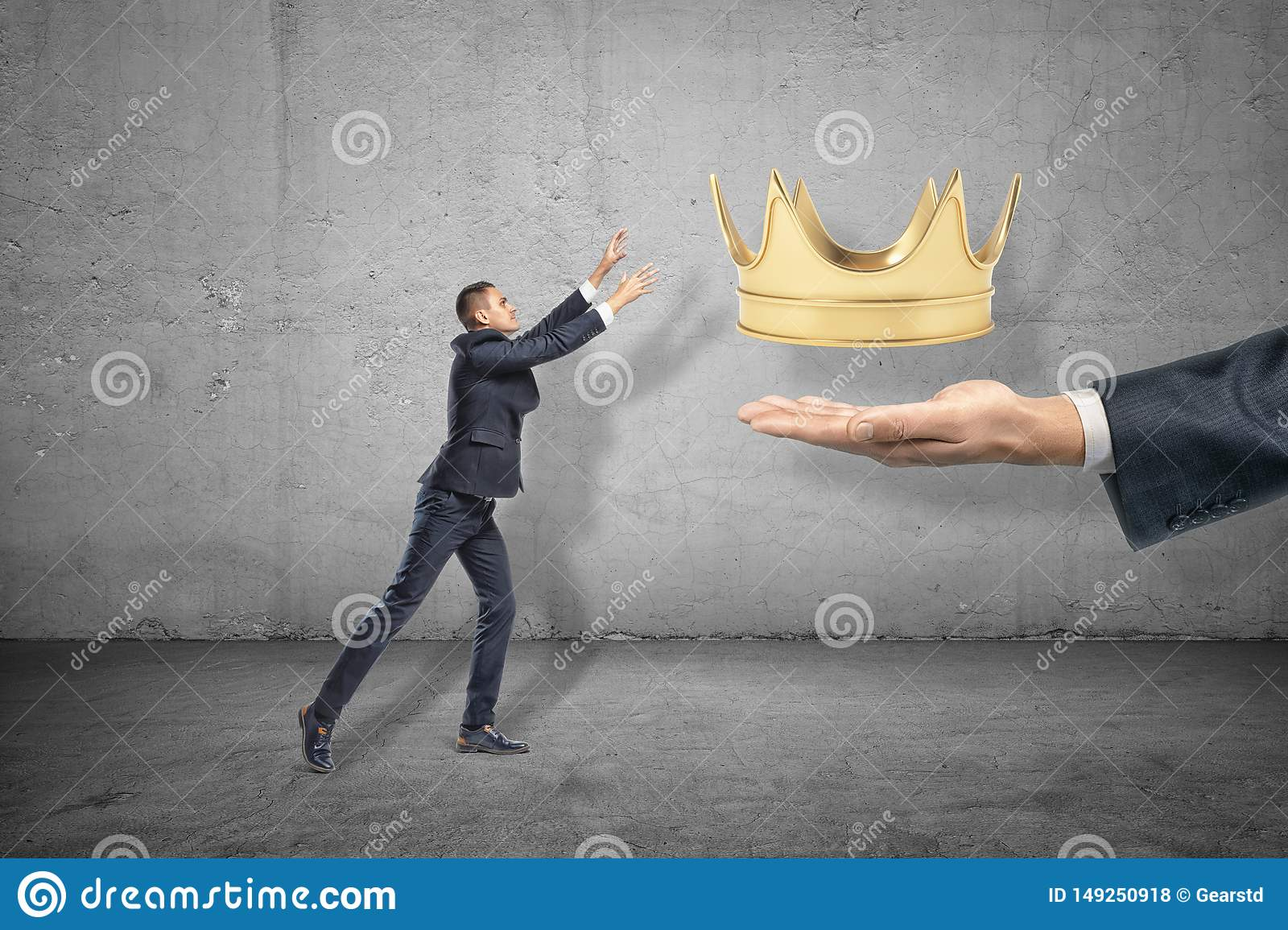 Side view of little businessman reaching out for gold crown that is levitated above big man`s hand emerging from right.