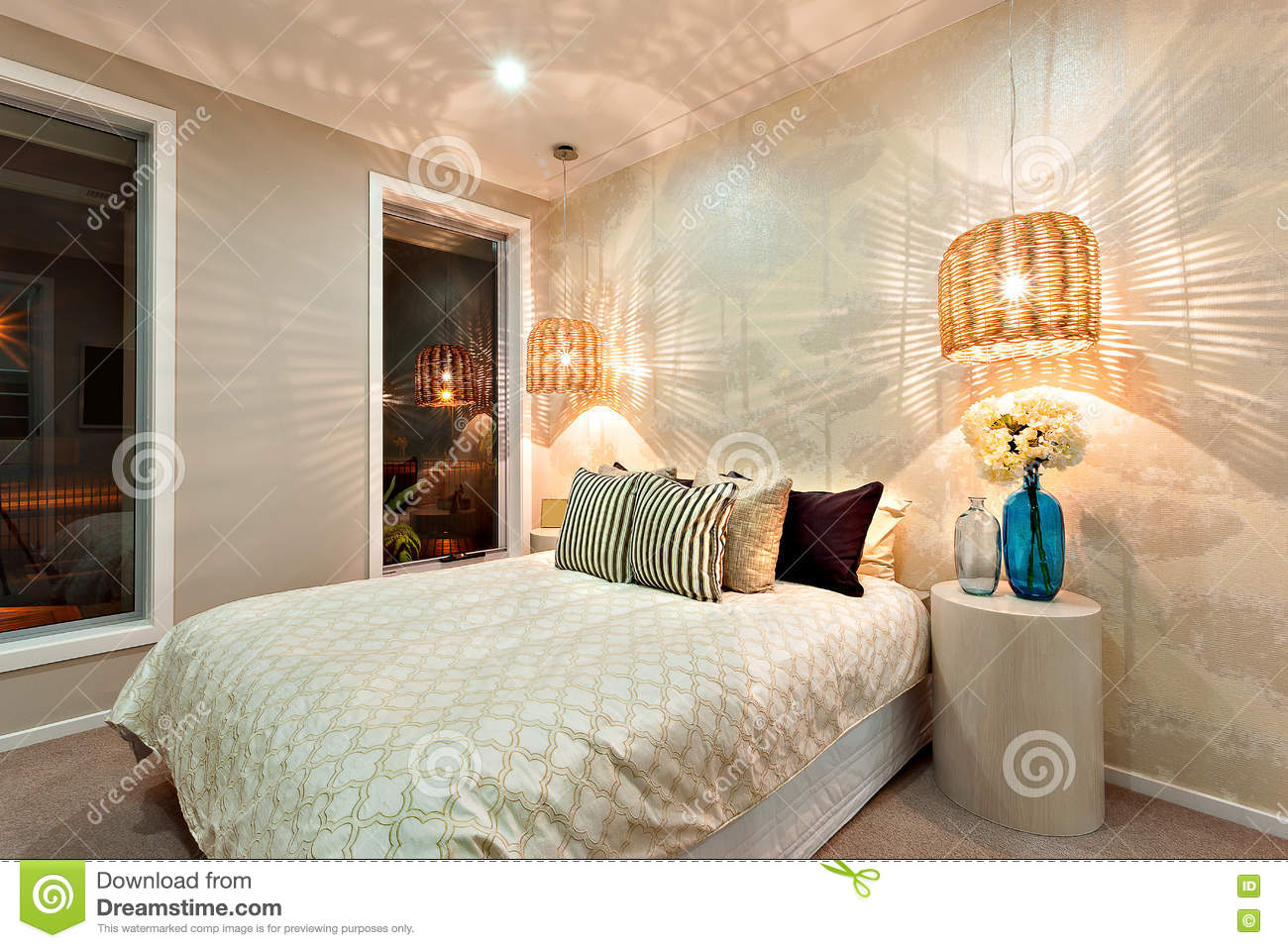 Side view of a luxurious bedroom with a bed