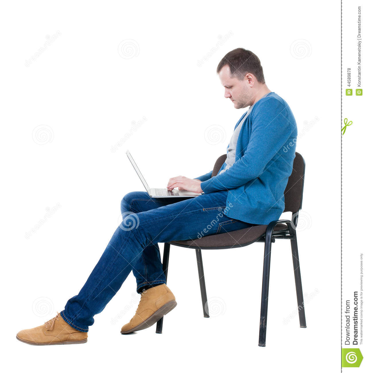 Side view of a man sitting on a chair to study with a for Sitting chairs