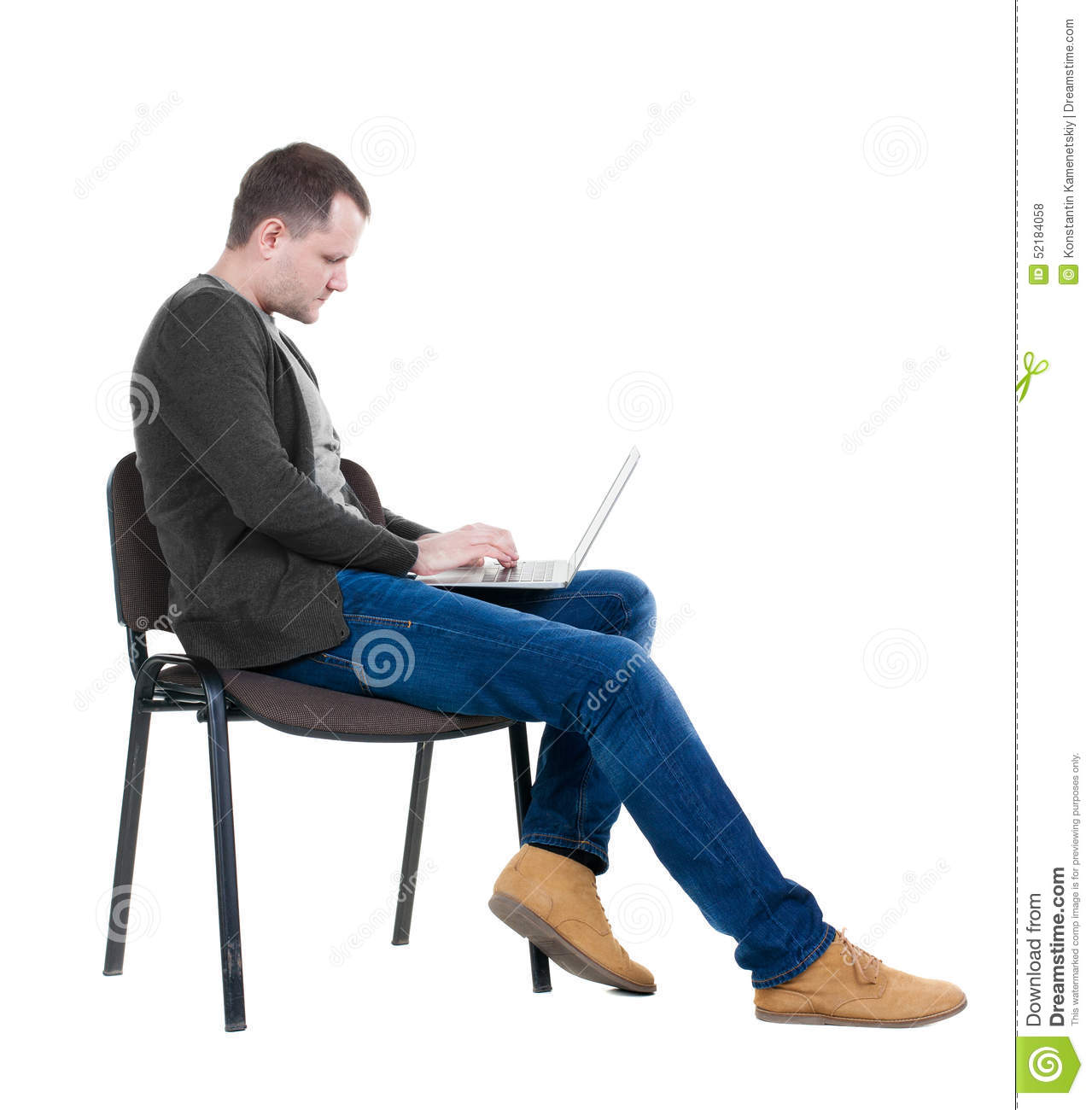 Side View Of A Man Sitting On A Chair To Study With A