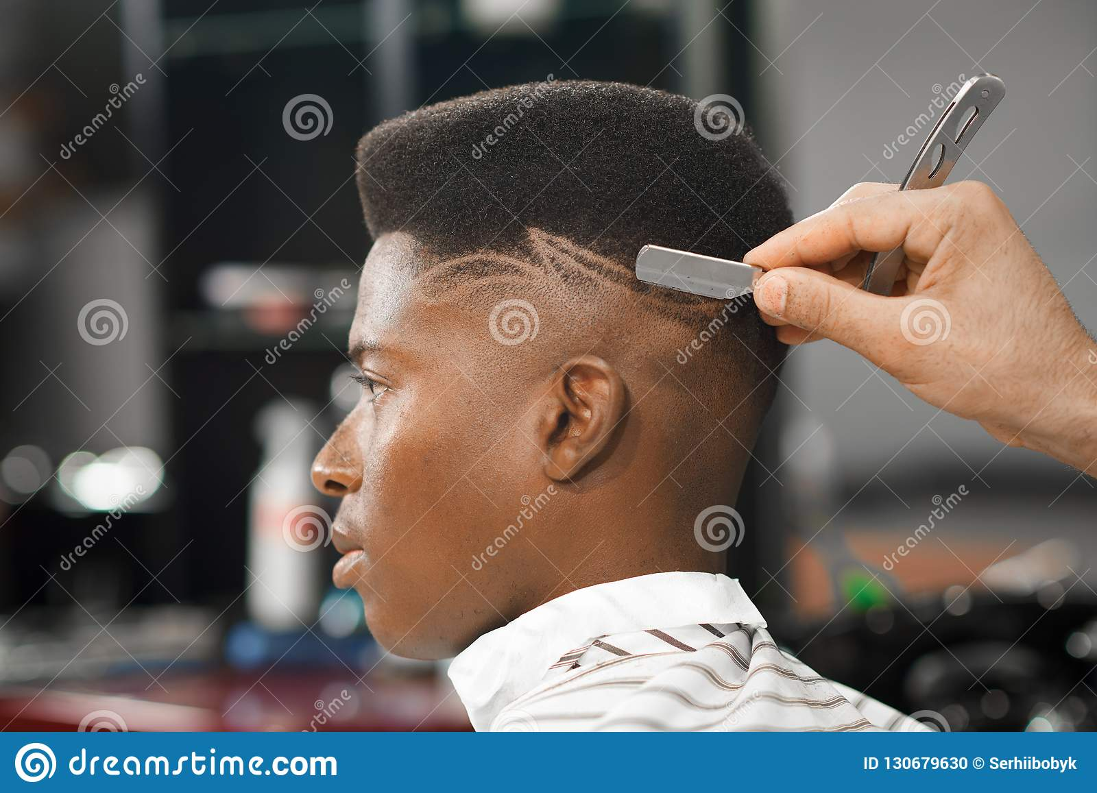 Side View Of Man With Stylish Haircut In Barber Shop Stock Photo