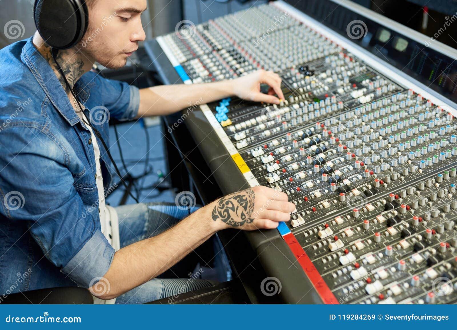Man creating music in recording studio