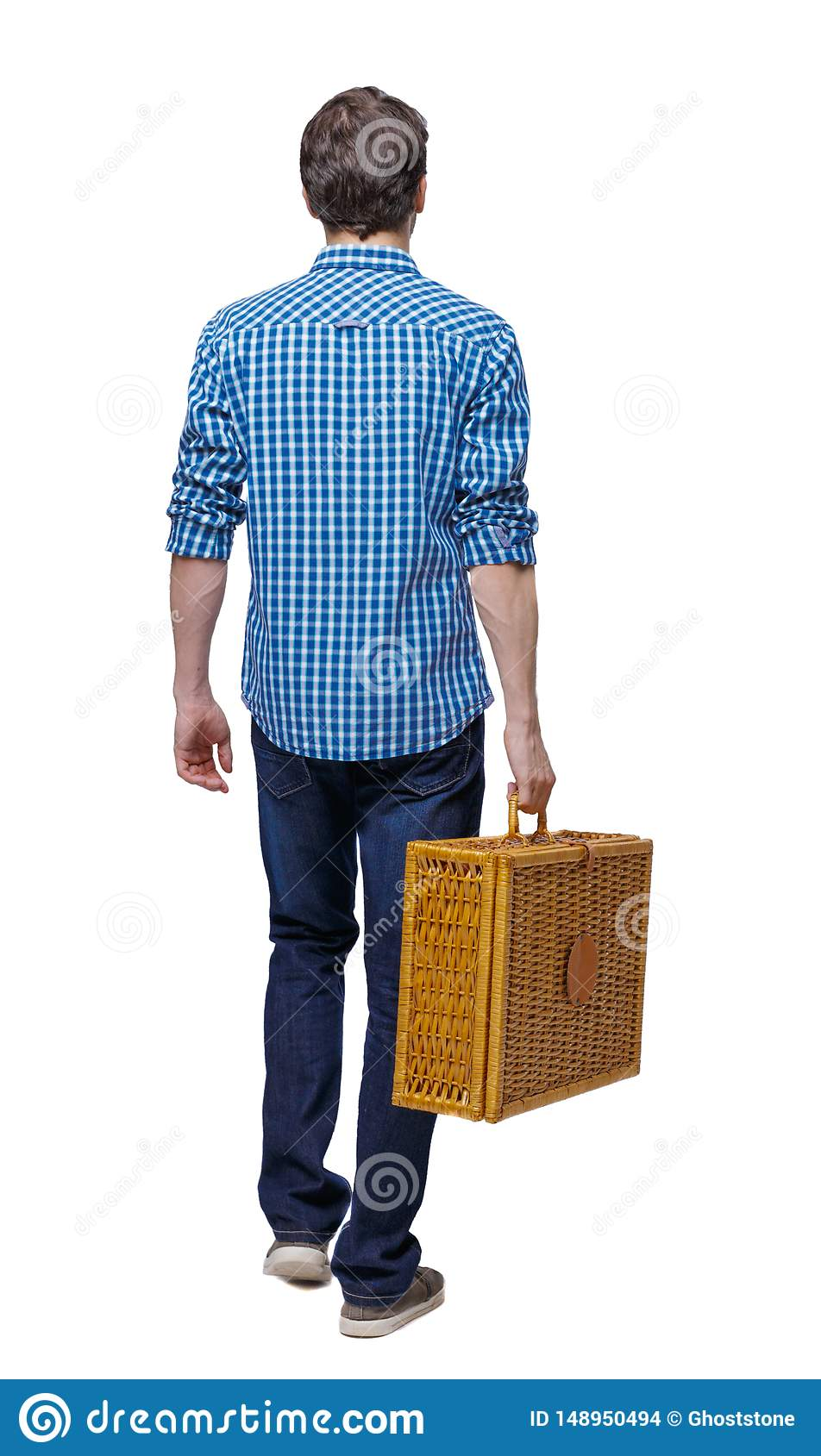 Side view of a man walking with a picnic bag