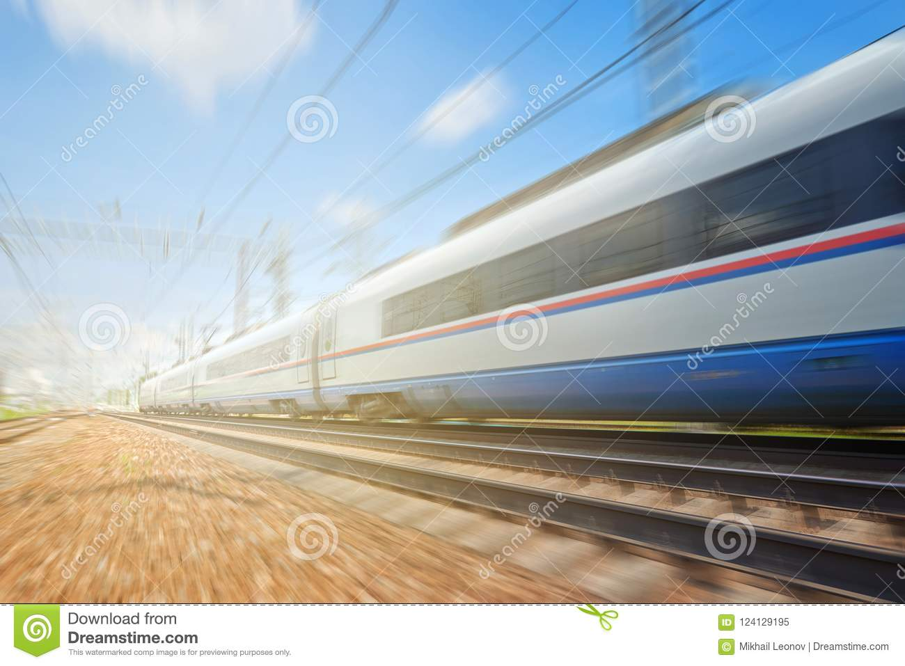 Side view of the moving ultra high speed train runs on rail way with railway infrustructure in the blurred background with flare e