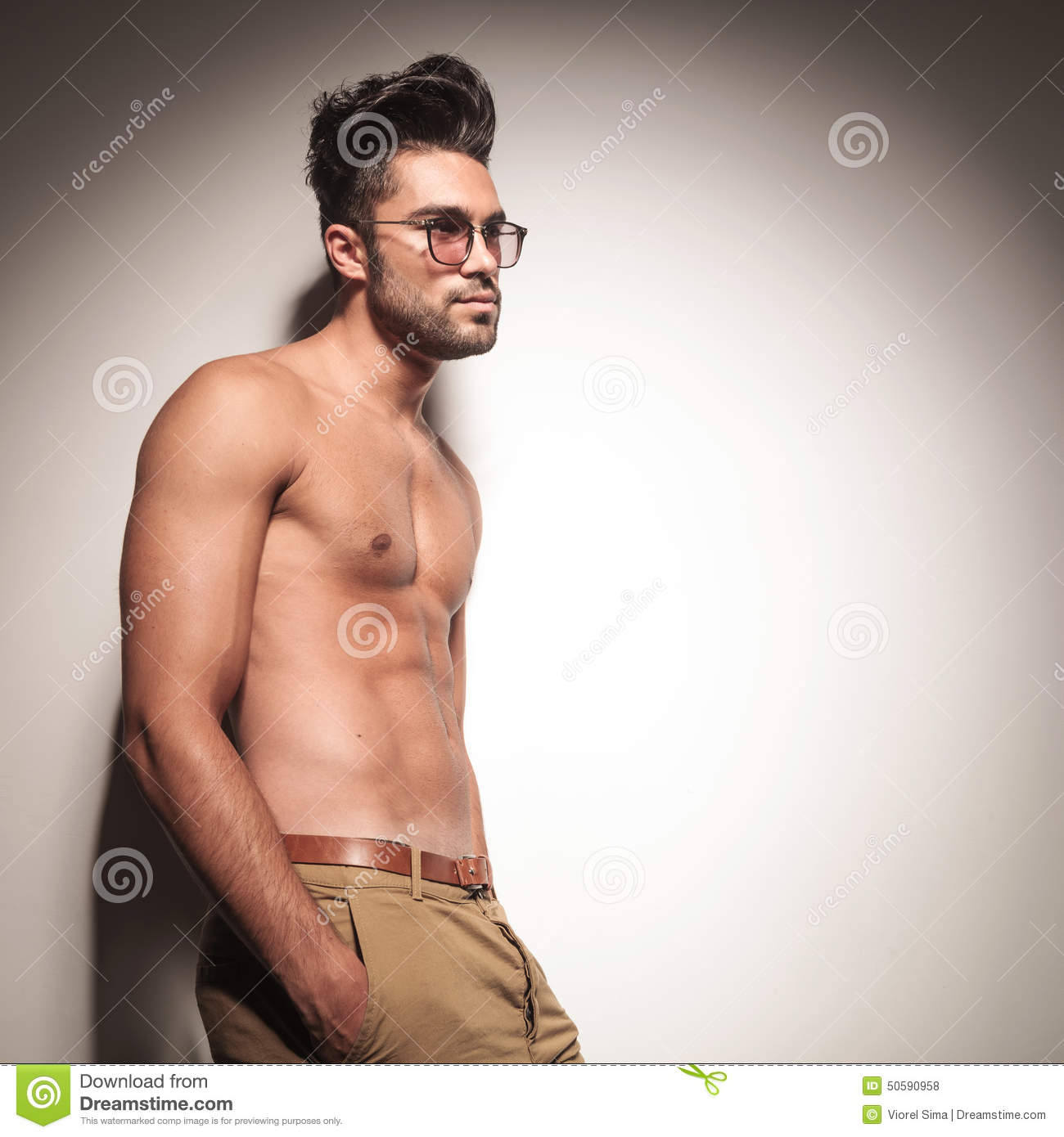 side view of a naked man leaning on a wall stock photo - image of